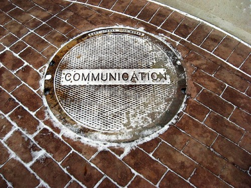 Photo of manhole cover with Communication written on it