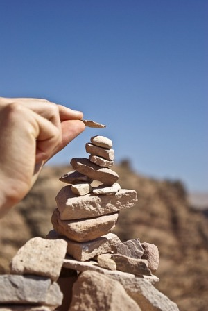 Photo of stacking small stones in the desert