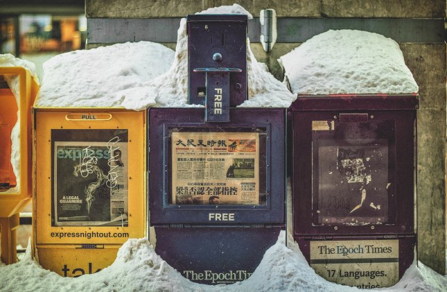 Newspaper stand in the snow