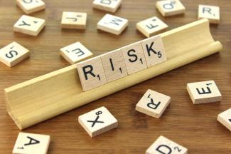 "Scrabble tiles reading ""RISK"""
