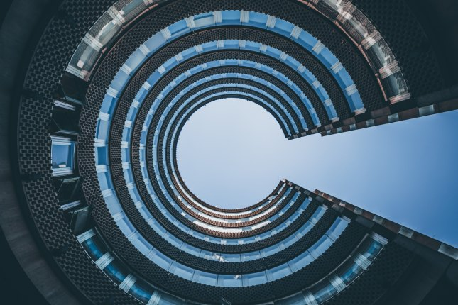 Photo of circular building that looks like the letter C