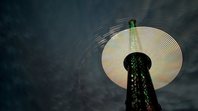 Photo of amusement park tower at night