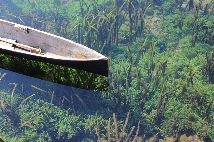 Photo of a canoe in clear water