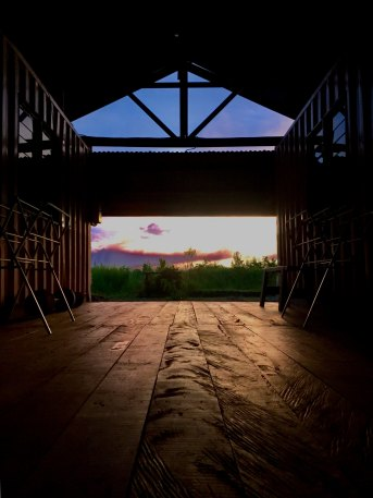 Photo of open sky seen through barn doors