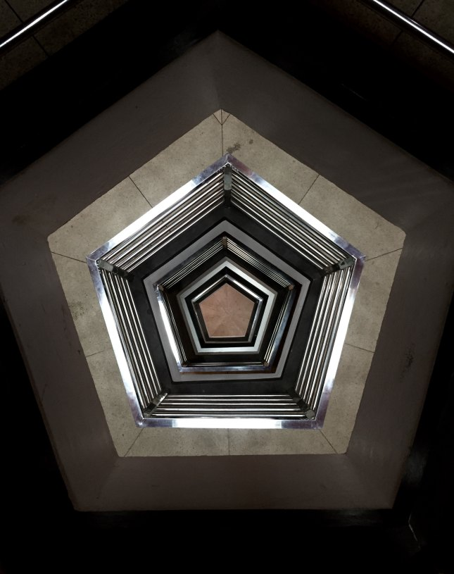 Photo of pentagonal view down a stairwell
