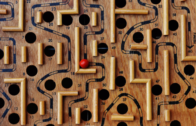 Photo of board game with ball moving around a maze