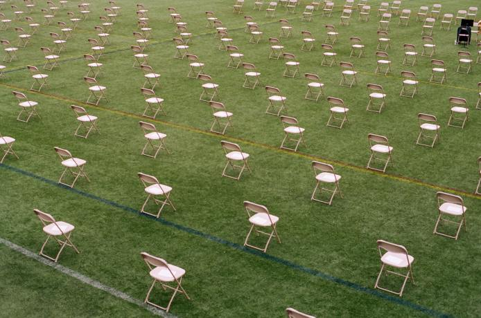 photo of empty chairs in a field